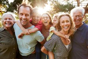 multigenerational family smiling, about lovett dental cinco ranch