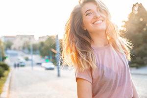 woman smiling, teeth cleaning cinco ranch tx, about lovett dental cinco ranch