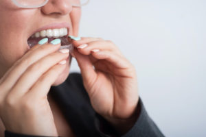 woman using nightguards for her teeth