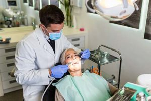 an emergency dentist works on a patient