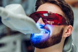 man undergoing teeth whitening